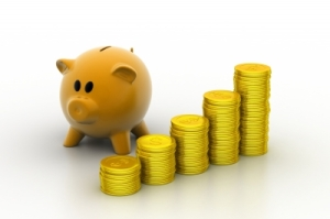 """Piggy Bank With Gold Coins"" by cute image Freedigitalphotos.net"