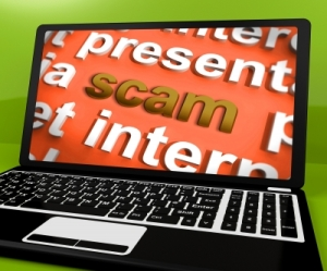 """Scam Laptop Shows Scheming Theft Deceit And Fraud Online"" by Stuart Miles Freedigitalphotos.net"